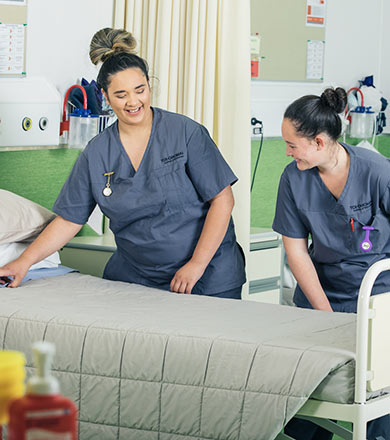 Nursing students making a bed