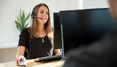 Student on a business admin course, using a headset