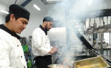 An image of students cooking for charity