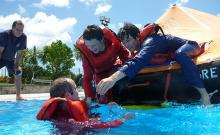 Maritime students spend time in the pool practicing skills they'll need in their careers