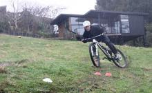 Mountainbiker riding down a hill in Rotorua